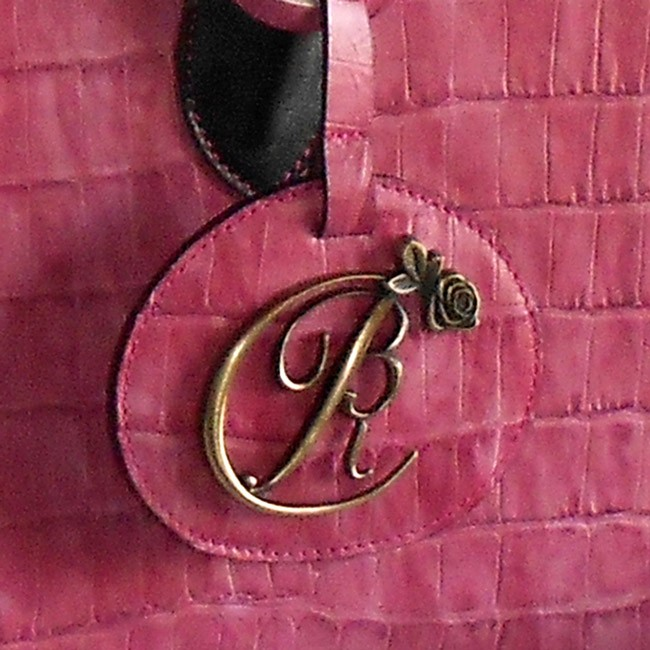 luxury leather bag Strauss Logo